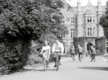 Cycling in front of President Hall.