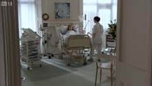 Recovering patient in a hospital room, either the Runnymede Room or one of the President Hall offices.