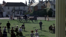 A hearse crosses Englefield Green in front of the Barley Mow pub.